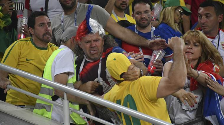 serbian fans fight brazilian fans on the stairs of the stadium